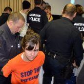 Activist Brigette DePape cuffed by VPD.