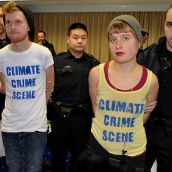 Climate justice activists Peter Oxford and Fiona De Balaszi Brown cuffed.