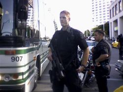 suddenly an ERT cop brought this big gun out and handed it to this tall guy