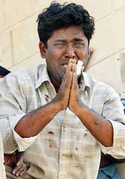 A young Muslim in Gujarat begging with tears not to harm him and his family, during the 2002 Gujarat massacre of muslims in India.