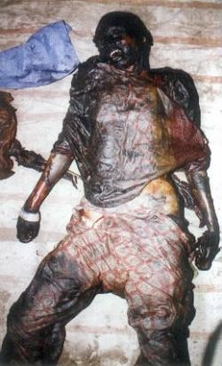 Charred remains of a Muslim woman in Gujarat state. The result of Genocide  under the leadership of Narindra Modi.