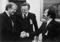 Navigating power. My dad shakes hand with the government who would later cage him.