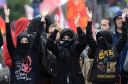 The black bloc in Egypt say they are the defenders of protesters opposed to President Mohamed Morsi's rule [AFP]