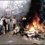 Genocidal mobs burning-muslim homes in Gujarat, all under the eye of Narindra Modi the chief executive of the state.