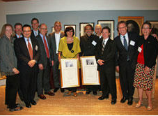 Amy Larkin from Greenpeace with reps from Coca-Cola, PepsiCo, McDonald's, Unilever, and the UNEP receive an award at Harvard, May 2011
