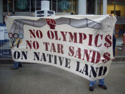 Banner displayed during anti-olympic rally on May 2009