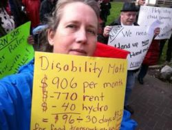 housing costs, low assistance rates cause homelessness in BC (pictured Roslyn Cassells at Inclusion BC demo)