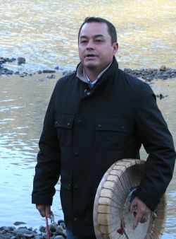 AFN National Chief addressing wild salmon paddlers on the FRaser River shore, 2010.