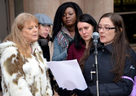 Reading the names of the missing women.   photo: murray bush - flux photo